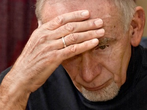 Elderly man sad and depressed