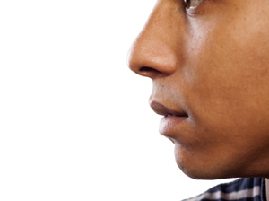 close up shot of the nose and mouth of a dark-skinned young man